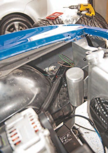 You can mount your ECM in almost any location but you don't want it exposed to moisture or extreme heat. Make sure the harness is the proper length for the intended mounting location. This is a vital component so make sure it is properly protected. I placed mine under the front fender, so it's away from any moisture (the Mast ECM comes with mounting pads). It's important to create a small space under the ECM for airflow to avoid overheating. Other popular places are under the dash and at the firewall. It's best to create an open area for the ECM wherever you decide to mount it. Solidly mounting it means bolting it through a rigid structure with a vibration dampener such as rubber pads, by far the most common and best practice.