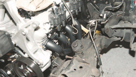 The Hooker header had plenty of clearance to the steering box, but it was quite tight. If you're running a power steering box (not like mine), you might have to dimple the header or find another solution. Most folks just use a ballpeen hammer to make that indentation.