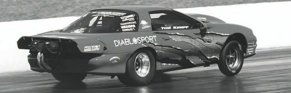 The adjustability and boost capability of turbocharging has made it the power adder of choice for most professional and semi-professional drag racers in the Fastest Street Car series. One of the quickest competitors has been Tom Kempf, whose red, single-turbo Camaro was capable of mid-7-second ETs.
