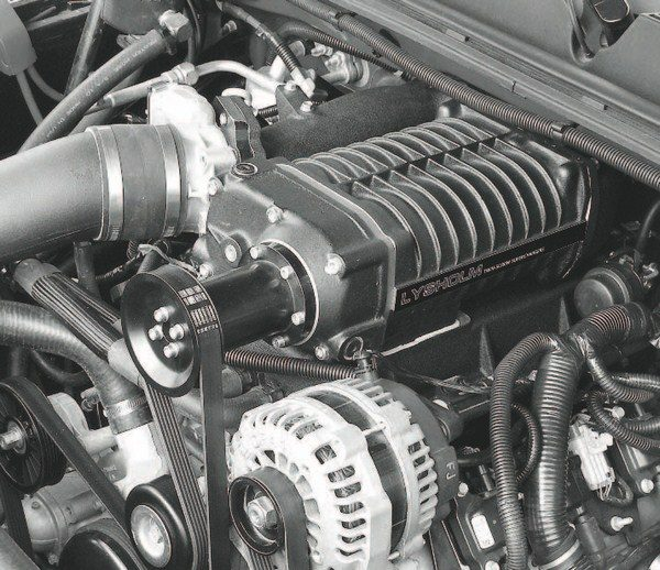 Vortech's twin-screw supercharger system for 5.3-liter LS-powered GM trucks includes an integral bypass valve within the supercharger housing. The kit also includes a charge-cooler/intake-manifold assembly (with fuel rail mounts), higher-rate fuel injectors, pump system for the intercooler, and coldair- style intake system. Tuning calibration is provided through a DiabloSport Predator programmer. Similar systems are expected for a variety of other LS-powered vehicles.