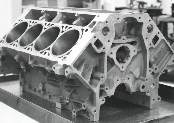 The standard cylinder block for the 7.0-liter LS7 engine is the foundation for the LS9.RS. It is aluminum with pressed-in steel bore liners and forged-steel main bearing caps. Machine work prior to assembly includes deck-plate honing of the cylinders and line boring of the crankshaft main bearing surfaces.