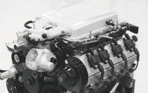 """When the testing of the engine was completed, Pratt & Miller turned to the aesthetic considerations. The """"hat"""" of the intercooler was painted to match the exterior color of the car, and the original """"LS9 Supercharged"""" embossment was milled off. An """"LS9.RS"""" badge or something similar will likely go in its place, but it looks nice and clean as is. Also, the valve covers were color coordinated and several other accessories were either painted or detailed to give the engine a more premium appearance."""