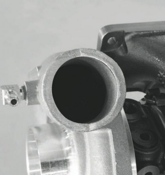 The compressor side of the turbocharger is what sends fresh air under pressure into the engine. A common misperception about turbos is that exhaust gas is somehow part of the boosted air charge. It is not. Exhaust gas is only used to spin the turbo in order for the compressor to generate a pressurized charge of fresh air.