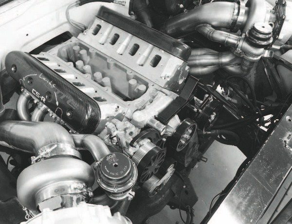 Packaging a twin-turbo system can be challenging, even with the relatively open space of a full-size truck's engine compartment (seen here). Also, the size of the turbochargers determine the most effective mounting position. A pair of small turbos is comparatively easy to mount directly off the exhaust manifolds or slightly below them. Larger turbos (as seen here) need more room. The system seen here was designed to accommodate a pair of larger turbos.