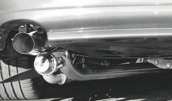 Beneath the bumper of a late-model Pontiac GTO/Holden Monaro, is a Squires Turbo Systems turbo kit. The remote-mounted turbo drastically reduces underhood temperatures and eliminates the need for a costly set of new exhaust manifolds.