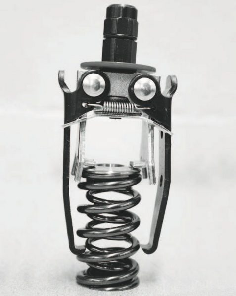 A valvespring removal tool (seen here) is required to squeeze the spring's coils to remove the valve keepers and retainers and to also re-insert the keepers and retainers during installation. This spring tool is from Performance Tool (PN W84001) and is available from Northern Tool and Equipment.