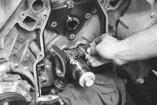 The timing-gear tensioner is the next component to be removed.