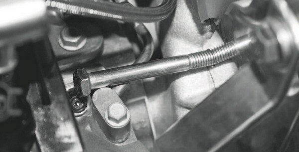 It's vitally important to follow the assembly manual closely. Here, the installer made an assumption about the blower mounting bracket's hardware, but didn't take into account the interference of the cylinder heads' coolant crossover tube, which prevented one of the bracket's bolts from sliding into its mounting hole. Rectifying the problem required backtracking, which added unnecessary time to the project.