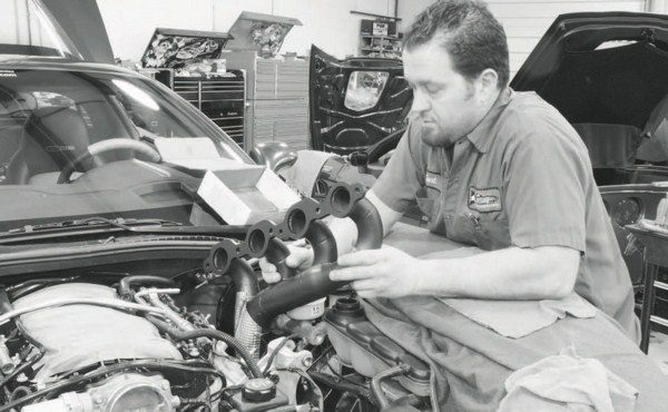 The system's installation started with bolting on the exhaust manifolds. With the hood removed and considerable chassis clearance on the Corvette, it was easy to do from the top of the engine compartment. Other vehicles require careful installation of the manifolds from the bottom of the engine compartment.