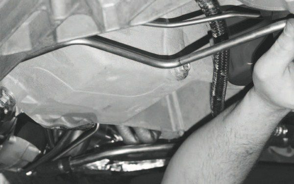 Like the oil lines, the water lines to and from the turbos are hard lines. They're also routed around the oil pan. This configuration is more timeintensive to fabricate and install, but if the lines were simply run directly under the pan, they'd be susceptible to damage if the vehicle were to scrape the ground.