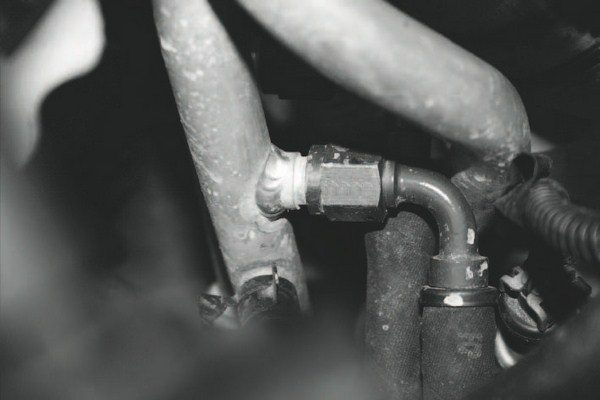 When it came to the coolant lines for the turbochargers, the inlet and outlet hoses were routed from the aluminum hard-line sections of the heater hoses. That required drilling holes and welding fittings to the factory lines. There are other ways to tie into the factory cooling system to provide the same effect, but with one of the hard lines dedicated to inlet and the other a dedicated outlet, this method is foolproof, even if it required careful, labor-intensive aluminum welding.