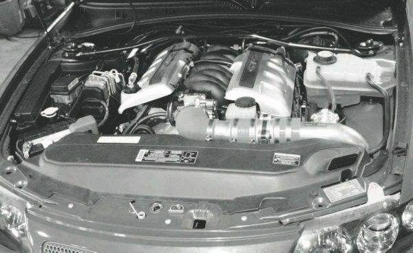 This underhood shot of the STS-equipped GTO reveals no clues that there is a turbocharger installled, apart from clearly non-original air intake that snakes down and under the engine compartment. The uncluttered appearance is a hallmark of the STS kit, as it doesn't require tricky fabrication to squeeze the system beneath the hood.