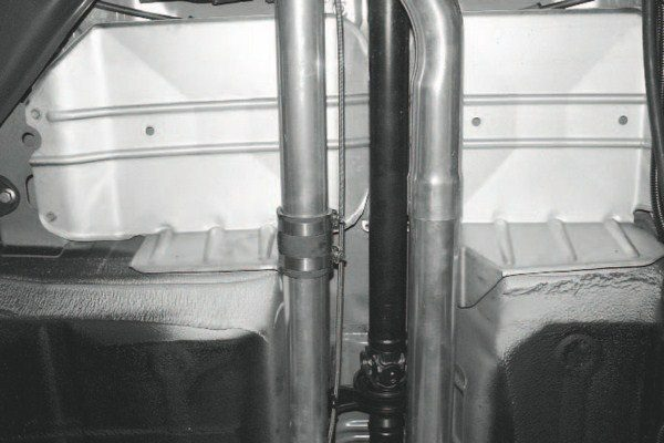 There's no down pipe or other exhaust system with STS's GTO kit. An exhaust outlet pipe simply mounts where the exhaust or down pipe would attach on a conventional system. The exhaust note with this design is acceptable and, the closecoupled catalytic converters that are mounted right off the exhaust manifolds are retained.