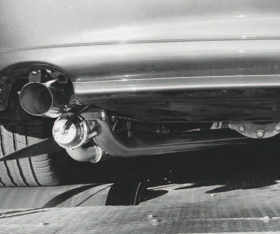 Here's a look at the finished installation. The blow-off valve is visible, but the system doesn't hang much lower than a regular exhaust system. A vehicle with a solid rear axle would benefit from better, over-the-axle tube routing, but the independent rear suspension of GTOs/Monaros, G8s/Commodores, and fifthgeneration Camaro demands tubing that runs under the axle.