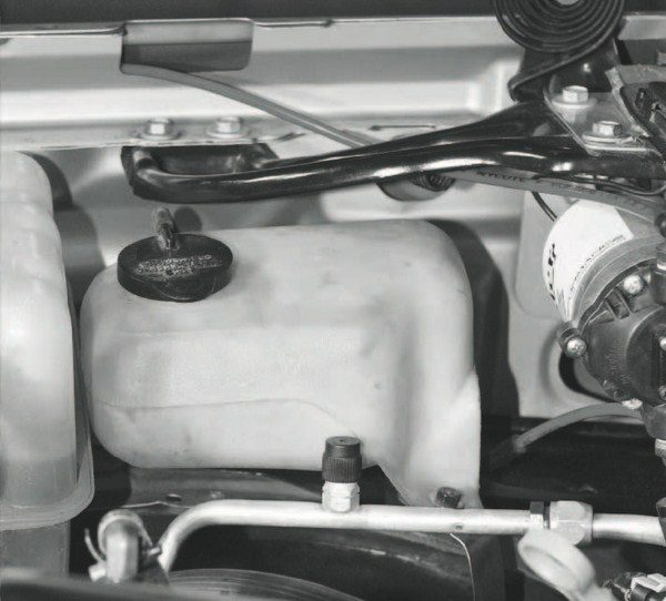 A homemade methanol injection system is relatively easy to build. A salvage-yard windshield-washer reservoir makes a perfect storage tank for the methanol solution. Filling up with windshield-washer solution is cheaper and easier than tuning the engine to run on high-octane racing gas, too.