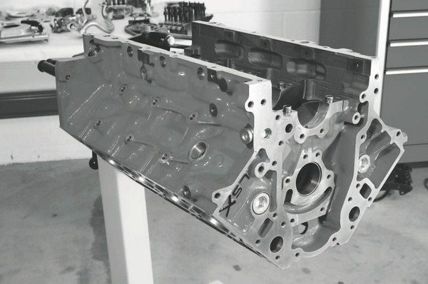 The GM Performance Parts LSX cylinder block was designed with forced induction in mind. Its cast-iron construction is not only strong, but makes it very economical; less than $2,000 from most retailers. It is offered in two deck heights: standard (PN 19166454) and tall-deck (PN 19166097). Tall-deck versions (delivered with a 9.700-inch semi-finished deck) require spacers for intake manifolds, because the heads are moved farther apart than with the standard, 9.240-inch deck height.