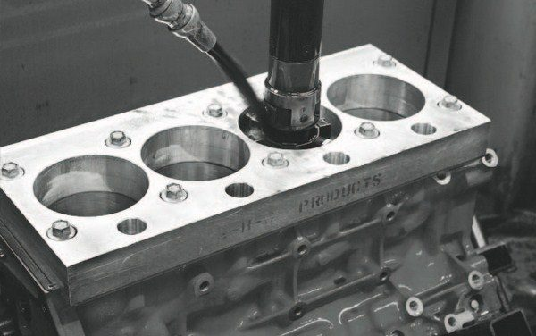 Another advantage of the LSX block's iron makeup is its capacity for machining. Its thick, siamese-type cylinders can be bored to 4.250 inches while retaining a minimum of .200-inch wall thickness. And, with machining, the standard-deck version can accept a 4.250-inch stroke, while the tall-deck version can take a 4.500-inch stroke. Proper machining, including the use of a deck plate as seen here, delivers a more accurate finished product that ensures greater cylinder sealing.