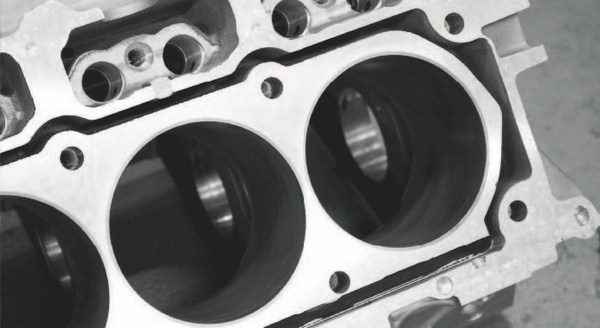 This is what the World Products Warhawk block looks like with the deck sliced off for an inside inspection. Note the cylinders and head-bolt holes are completely surrounded by a very generous water jacket, yet there is very thick material surrounding the cylinders. The extra-thick material adds strength to the cylinder areas, while also serving as a better insulator as the block warms and cools.