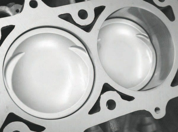 Ceramic-coated pistons can minimize both heat absorption and friction, but the builder must be extremely careful to ensure the coating is applied by a knowledgeable, experienced vendor or by the manufacturer itself. Poorly applied coating material or an incorrectly prepped piston can result in the very hard coating flaking or peeling off in the cylinder. This can cause catastrophic damage, as the coating will typically score, scratch, or gouge the cylinder walls—effectively ruining the cylinder block. This risk is typically not worth it on street/strip engines producing less than 1,000 hp and/or less than 15 or so pounds of boost. Use coated pistons on highpower racing engines where engine temperature will be greater.