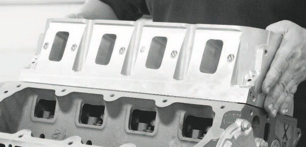 There is an almost endless list of possibilities when it comes to boost-friendly cylinder heads for LS engines. The excellent port design and large-capacity runners allow for easy and efficient cylinder filling. Ensuring intake manifold compatibility with the heads' intake ports is the only major caveat when selecting them for a supercharged or turbocharged combination.