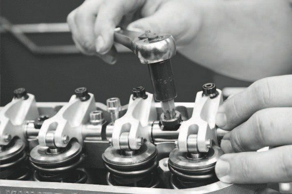 Shaft-mount rocker arms, such as the Jesel Pro J2K 1.8:1-ratio rockers (seen here), offer exceptional stability and virtually eliminate problems with valve lash as the engine quickly revs to the upper-RPM band. However, valve cover clearance is an issue when using shaft-mounted rockers, requiring machining of the valve cover rails on the heads and/or a valve cover spacer to prevent interference. Some aftermarket heads, such as World Products' Warhawk heads and GM Performance Parts' LSX heads, are cast with taller rails to accommodate taller rocker-arm assemblies.