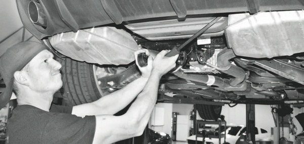 Because of the long length of the fully welded stock system, it is much easier to start the project with the car on a lift. Although it is technically possible to remove the stock system without a lift, the access and leverage needed to unhook some of the hangers makes the job infinitely easier with a lift. The most difficult aspect of the job requires a pry bar to remove the muffler hangers. They're very hard to see and even harder to remove without considerable leverage.