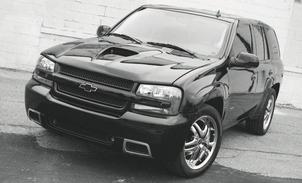 """By channeling torque through all four wheels, the 4L60 transmission of the allwheel- drive TrailBlazer SS has proven especially vulnerable to failure when the extra load of a blower or turbo system is introduced. That's mostly due to tuners who eliminate the """"torque management"""" feature that briefly closes the throttle between shifts. On these AWD vehicles, that puts an inordinate strain on the powertrain. Typically, the transmission starts slipping between the 1-2 shifts or won't hold the gears, especially fourth gear. Any enthusiast contemplating a supercharger or turbo system for a Trailblazer SS should factor in the cost of an upgraded transmission, or make sure to leave the torque management alone."""