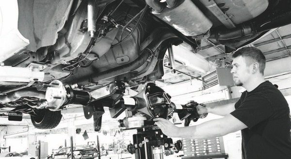 After the parts were transferred to the new axle, it was simply a matter of lifting it into place. This is where a shop with a lift and a jack comes in handy, because the axle is very heavy and awkward to maneuver. The fit of the S60 axle was perfect. All the suspension components bolted right back up without a problem.