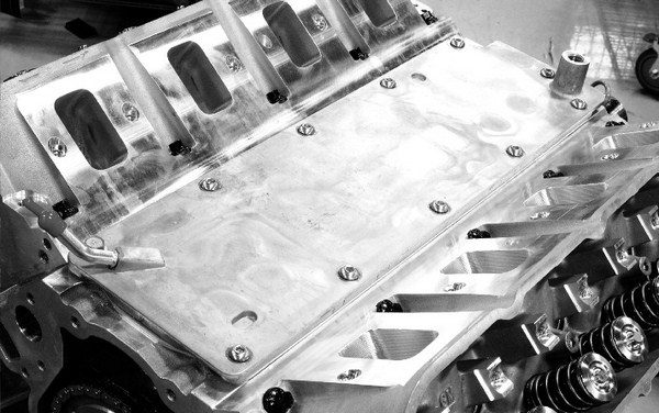 In addition to superb power potential, LS small-blocks are far easier to work on than their Mouse predecessors. A lifter plate seals oil inside the lifter valley, which prevents it from splashing on the bottom of the intake manifold and heating it up. This means that the intake doesn't need to be glued down to the block with silicone every time it's removed and installed.