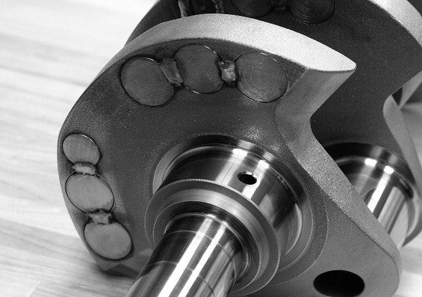 Callies offers 4.500-inch forged crankshafts for applications running tall-deck blocks where ultimate displacement is the goal. One of the drawbacks of extreme-displacement combinations is that their rotating assemblies can get rather heavy. This isn't a huge deal, because large motors don't need to turn high RPM to make power. However, it does make balancing the rotating assembly difficult, and it can require adding several slugs of heavy metal to the crankshaft counterweights.