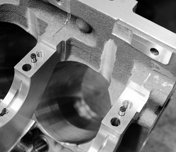 Even within the confines of a production block, a very large crankshaft can still fit with the right prep work. By removing metal from the bottom of the cylinder sleeves and into the bottom of the crankcase to make room for the rod bolts, a builder can make this LS2-based ERL block accommodate a 4.500-inch-stroke crank.