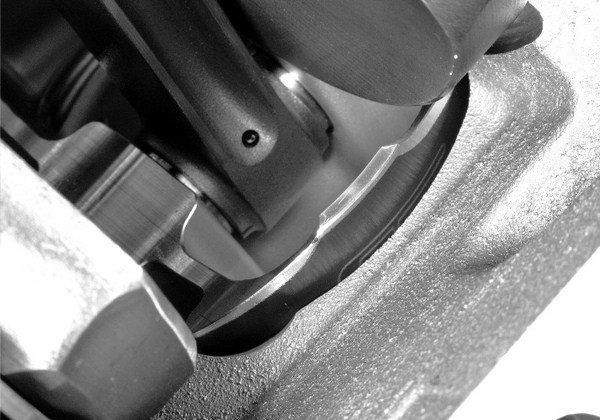 If a piston is pulled too far down the cylinder bore, it has a tendency to rock from side to side at BDC. This not only accelerates wear, but it also causes the rings to lose contact with the cylinder wall, which severely compromises oil control. In such applications, custom pistons with tapered skirts are required.