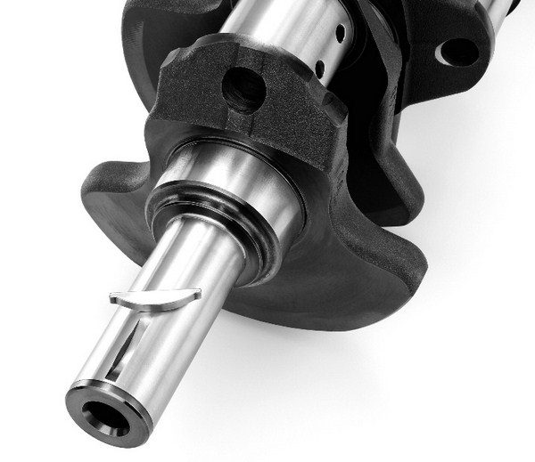 Like the LS7's crank, the crankshafts in the LS9 and LSA are built from forged steel. Because the crankshaft must cope with the rigors of driving a supercharger, it has a keyway integrated into the crank snout to prevent the harmonic balancer from spinning out of place. (© GM Corp.)