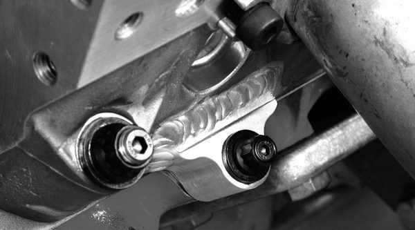 Many aftermarket blocks are offered with a six-bolts-percylinder bolt pattern, but they are still compatible with standard fourbolt heads, as long as the upper and lower bolts aren't used. An option is to weld tabs onto the heads, so that they can be bolted to the extra holes on the block.