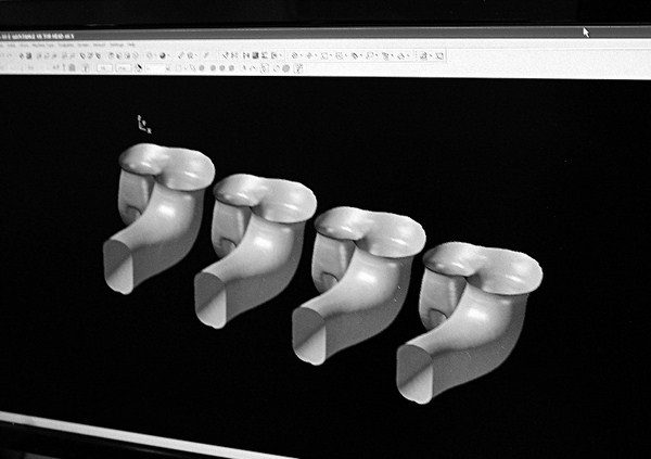 With symmetrical heads, such as GM Gen III/IV castings, the prototype ports and combustion chamber are cloned for the remaining three cylinders. This eliminates the need to design each and every port one at a time, and it ensures that every single port and chamber in the heads are identical, a feat that's nearly impossible when porting by hand. The port on the left is a hand-ported port, and the others have been cloned using computer software based on bore spacing of the block. The software is so precise that it allows modifying a hand-ported surface even further.